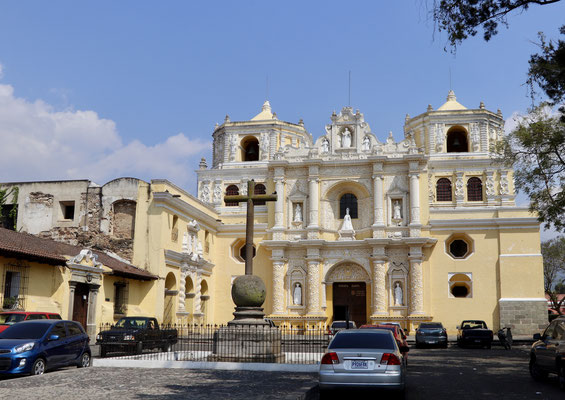 An important architectural baroque, yellow-white church La Merced in the middle of the city