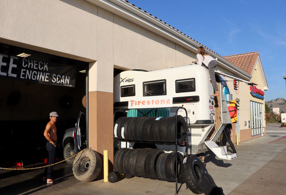 Luckily the Camper Truck just fitted into the garage so they could lift it up to do the oil change
