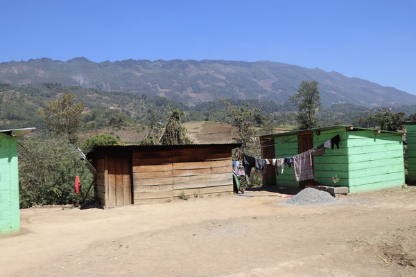 This is the kind of housing you see all over Guatemala very simple wooden huts with tin roofs