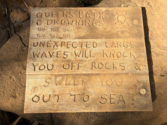 ..this sign carved in wood is placed on a rock as you arrive down by the rocks of Queens Bath...most tourists don't take it seriously