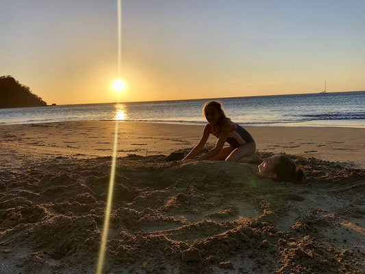 Lynn buried Mum in the sand..