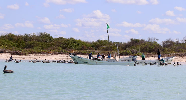 ..we went past fishermen hauling their nets..