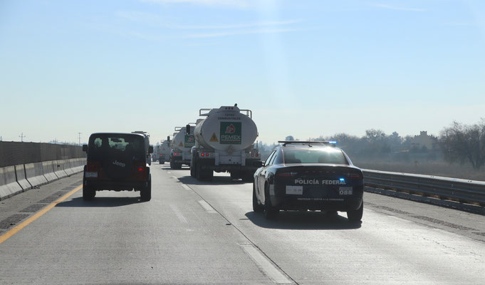 After a wonderful Breakfast with Paul & Irma we got back on to the road heading south. On the highway we passed a dozen Pemex trucks escorted by the police