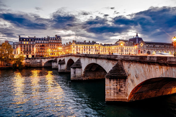 Walking tour at sunset along the Seine River in Paris