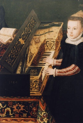 Woman playing harpsichord