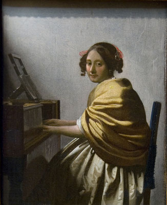 A Young Woman Seated at the Virginals by Johannes Vermeer, c. 1670–72