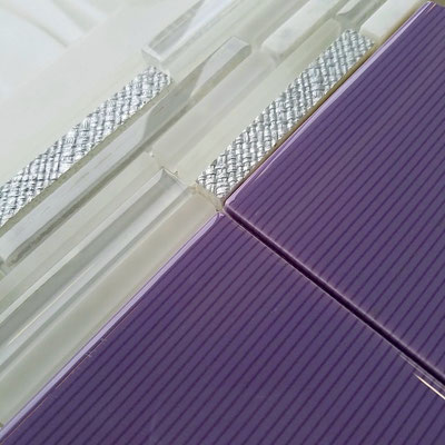 These purple pinstripe tiles are fun and modern and look great with a linear mosaic.