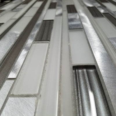 Brushed aluminum and gray and white matte and glossy glass mosaic