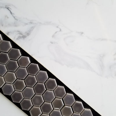 This dark grey mosaic has a soft hint lavender that picks up the warm grey veins in this marble look-alike quartz.