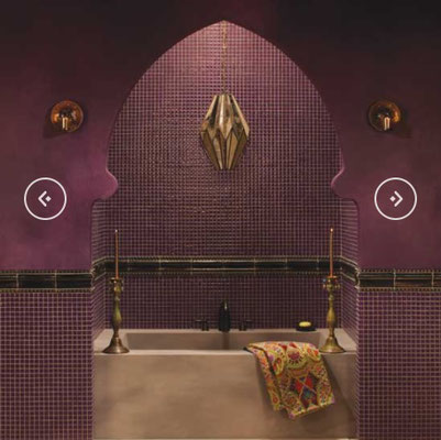 Dramatic and romantic, this Moroccan-style soaking tub is surrounded by a rich wine color.