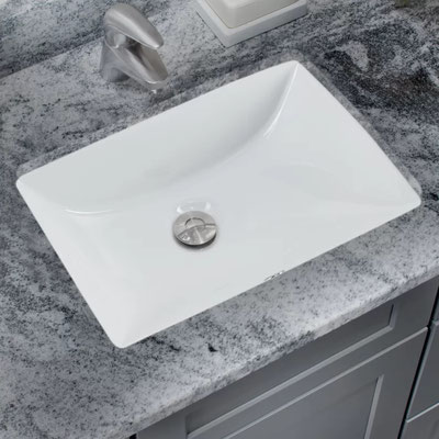 A white rectangular undermount sink is a modern touch in this white and gray granite countertop.