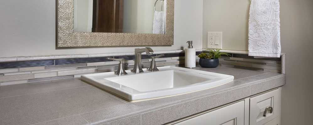These porcelain countertops use bullnose tile to finish the front edge of the countertop.