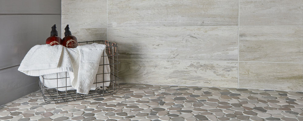 A stone-look porcelain tile with soft neutral pebbles for a spa-like aesthetic.