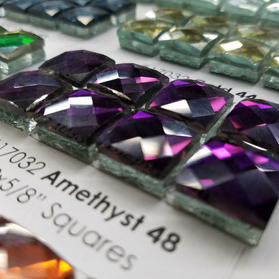Add a stripe of sparkle or a bit of bling to your backsplash with these faceted amethyst mosaics.