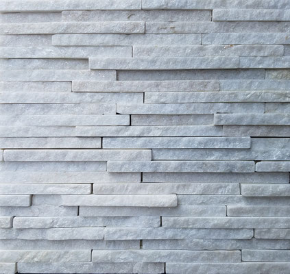 White quartzite is a hardy natural stone with sparkling quartz flecks. This stacked stone blends 3D drama with crisp white modernity.