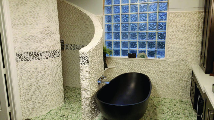Covering your entire bathroom in pebbles feels like you're bathing in some tropical island getaway.