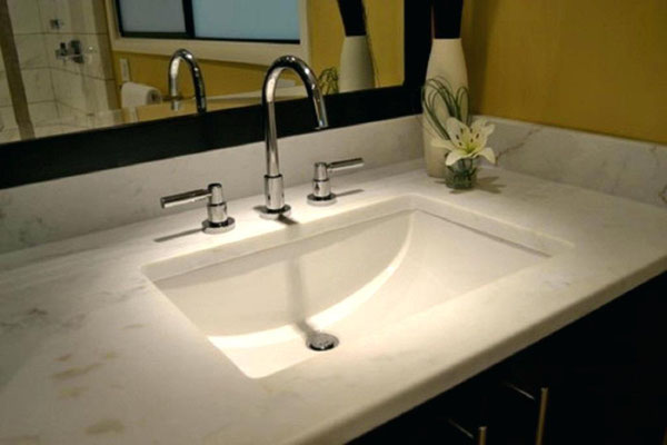 This white rectangle sink is a clean addition to this white marble countertop.