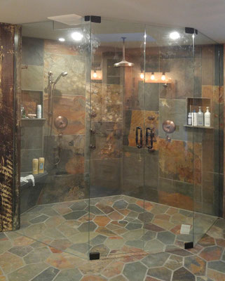 This frameless shower is the perfect way to show off the color of this curbless slate shower.
