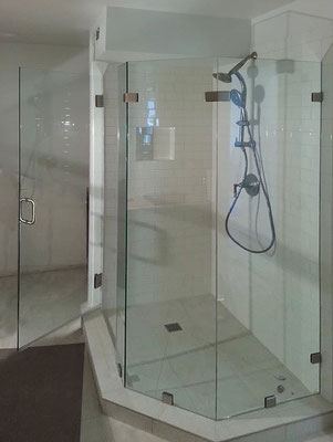 Show off a spacious shower with frameless glass panels.