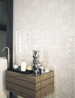 Glazed ceramic wall tiles with a patchwork pattern
