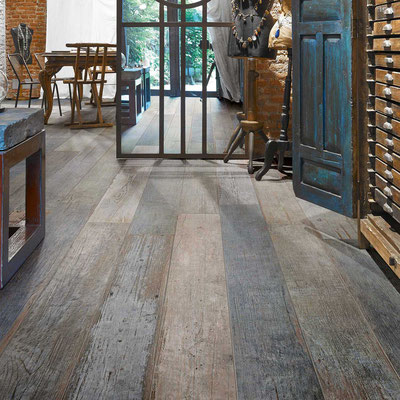 Rustic, reclaimed look in an entryway is great for muddy shoes.