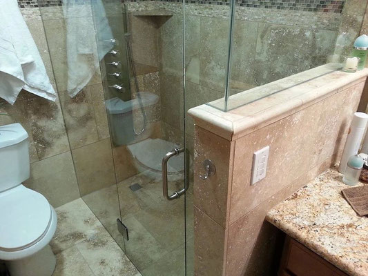 A frameless glass panel is the perfect way to keep water in while letting your design shine through.