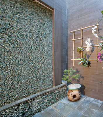 A wall of round pebbles makes for a great water feature!