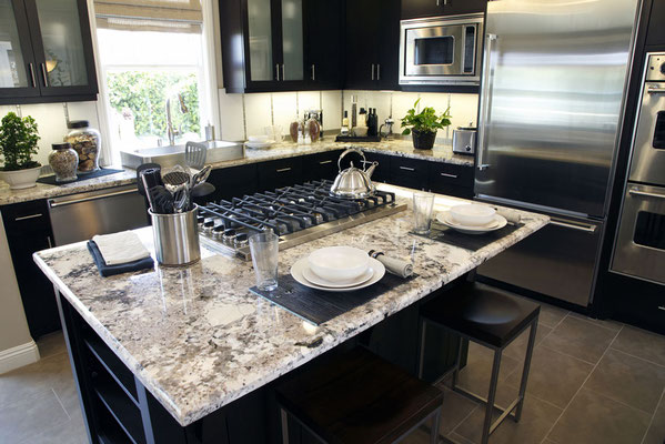 Alaska White Granite is a stellar blend of white, cream, taupe, gray, silver, and black.
