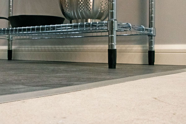 Schluter Vinpro-U is an ADA-rated tiny ramp from taller flooring to shorter flooring.