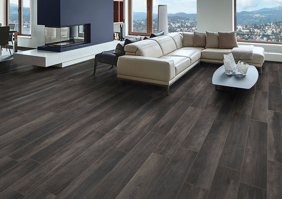 A dark, dramatic color grounds the floor and makes everything pop.