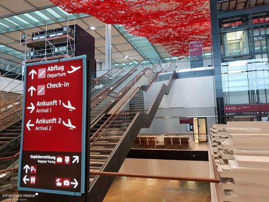 Terminal, Ebene E0 (Ankunft), Zugang zur Ebene E1 (Abflug)