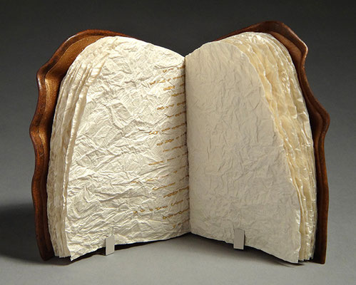 Yearning, Book One (2016) handwriting on crinkled paper, wet-formed leather covers, unique, 5 x 5.5 x 3 inches