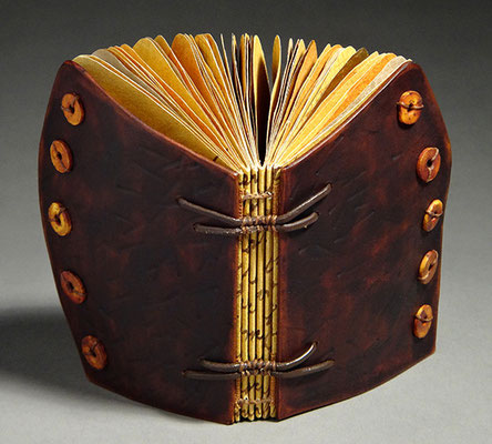 Luck, Book Two (2016) mixed media on handmade and tea chest papers, wet-formed leather covers, unique, 4.75 x 6 x 3 inches