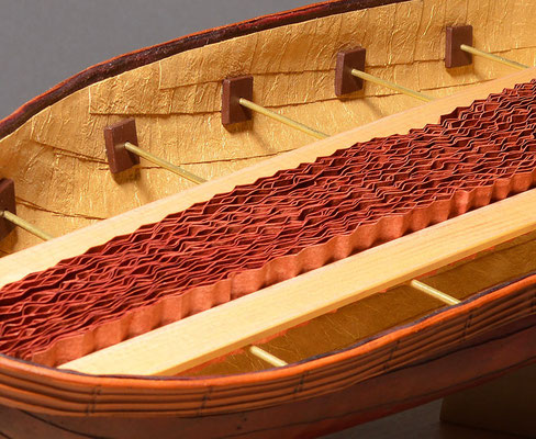 Adrift (2017) cuir bouilli formed leather, crinkled pastepaper, Lokta Metallic Gold paper, wood, brass rod, linen thread, 20 x 7.5 x 4.5 inches