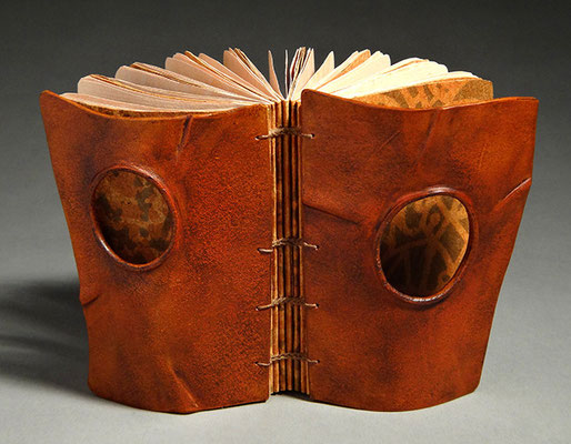 Remembering, Book One (2016) mixed media on lokta and charcoal papers, wet-formed leather covers, unique, 4.25 x 5 x 2.5 inches