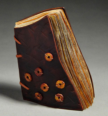 Luck, Book One (2016) mixed media on tea chest paper, wet-formed leather covers, unique, 4.75 x 6 x 3.5 inches