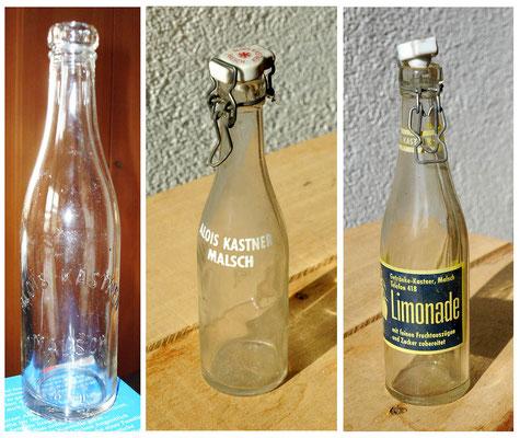 verschiedene Glasflaschen, links mit Glasprägung
