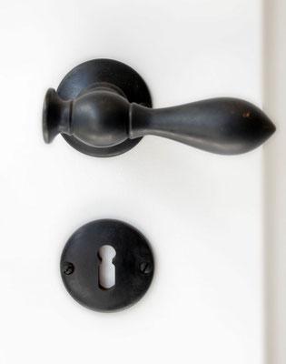 Rosetten mit Griff, Haus und Zimmertür