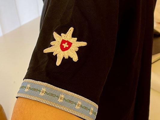 Polo mit Edelweiss Sticker