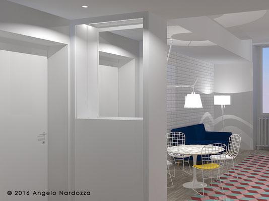"""La zona ingresso, con specchio e guardaroba nascosto da un'anta a scorrimento verticale. Questa zona è anche """"trait d'union"""" tra la cucina (in fondo) e la zona studio."""