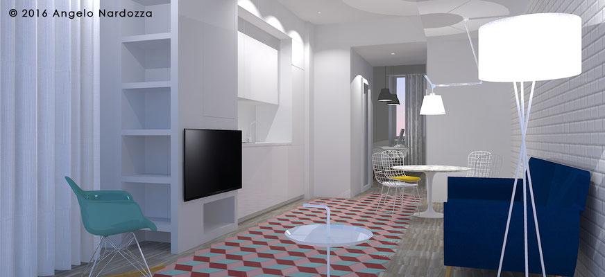 Zona living-cucina. A sinistra della cucina, caratterizzata da due file di pensili di diversa profondità, è presente un volume in cartongesso: questo sostiene il televisore, oltre a integrare dei ripiani a giorno e una dispensa, mimentizzata da un'anta.