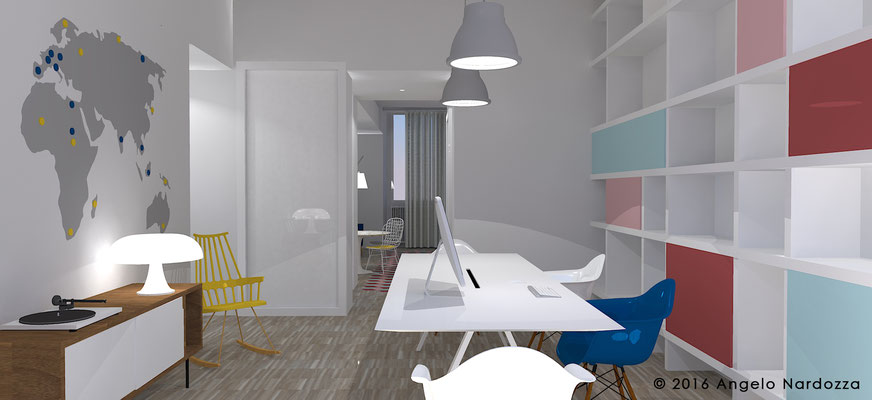 La zona studio, parte integrante della zona giorno e allo stesso tempo indipendente, grazie ad un accesso e a un bagno dedicati. A destra la libreria in cartongesso a tutta parete con ante che riprendono i colori delle cementine in cucina.