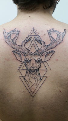 geometrical deer tattoo