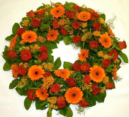 Gerberas naranja/ocre, rosas y verdes 400 CHF