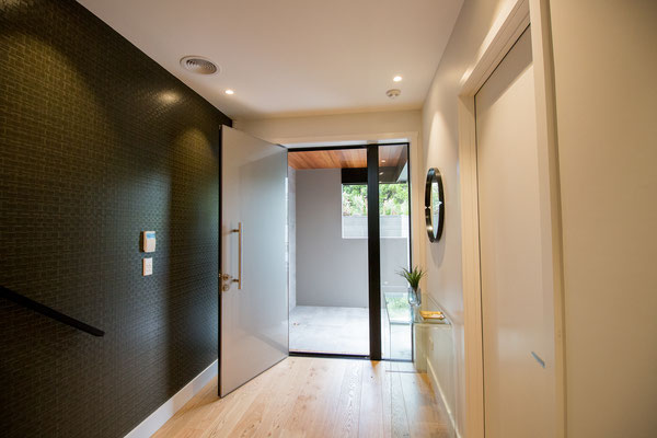 Wallpaper adds a wow factor and much needed texture to the entranceway.