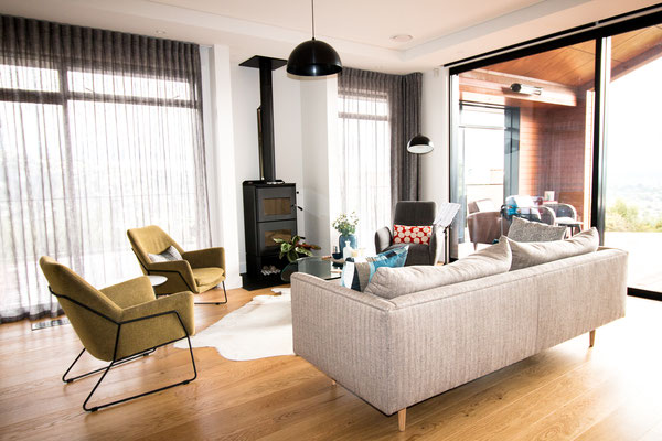 The family room is a beautiful informal space with the colours used peppered throughout the home.