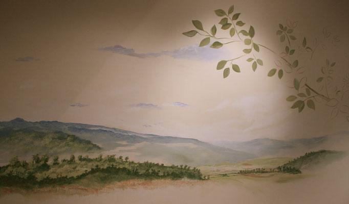 Das Wandbild zeigt in luftiger Malweise eine typische Landschaft der Heimat des Kakaos.