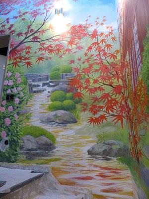 Detailansicht der Wandmalerei »Japanischer Garten« mit der Quelle des goldenen Baches.