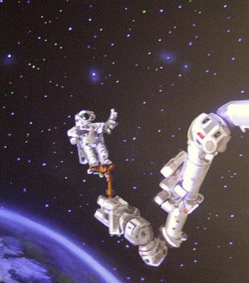 Astronaut bei Schwarzlicht-Beleuchtung.