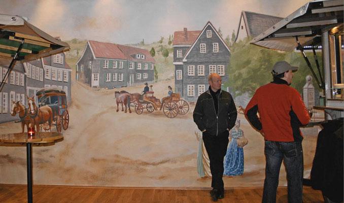 Eröffnungsfeier mit fertigen Wandgemälden.
